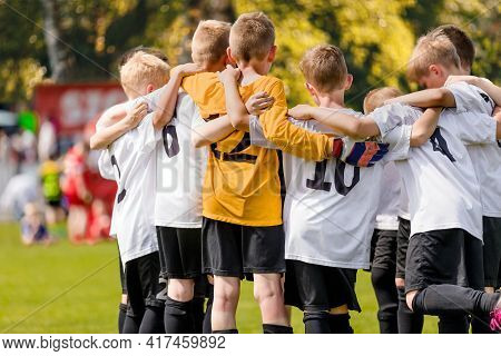 Group Of Happy Sports Boys Huddling In A Team. Happy School Kids Play Sports Together. Children Moti