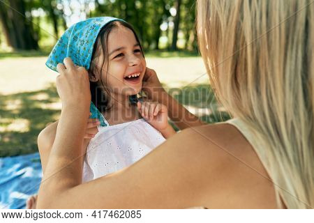 Cheerful Smiling Daughter Playing With Her Mother In Sunny Summer Day In The Park. Kid And Youmg Wom