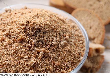 Fresh Breadcrumbs In Bowl On Table, Closeup