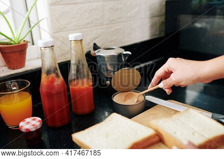 Close-up Image Of Young Woman Making Sandwiches With Turkey Pate And Ketchup For Breakfast