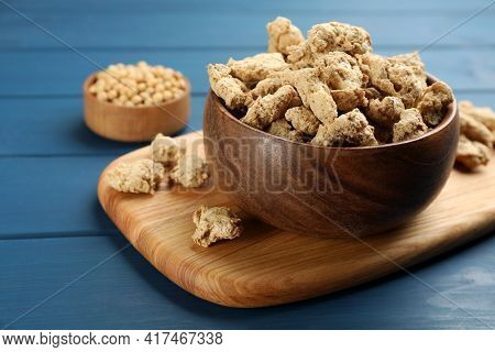 Dehydrated Soy Meat Chunks On Blue Wooden Table