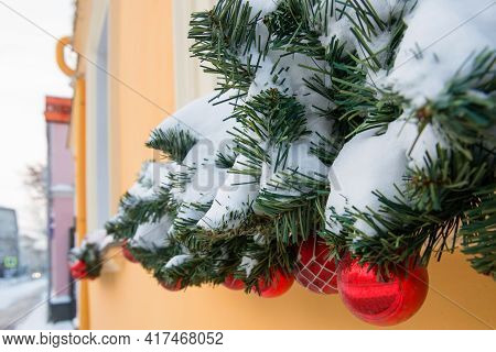 Christmas Decorations Displayed Outdoors By Window. Stylish Christmas Snowy Fir Branches With Festiv