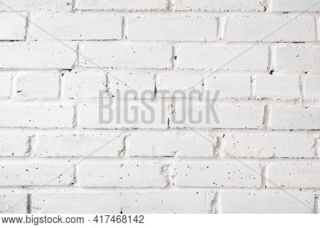 Rough Brick Wall Painted With White Paint