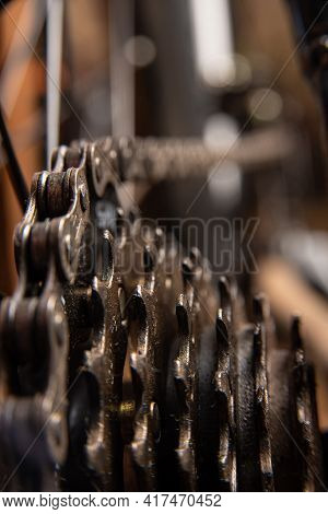 Bicycle Details, Gear Details Of Gears And Chain, Dark Abstract Background, Selective Focus.