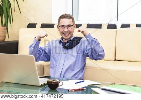 The Office Worker Happily Threw His Hands Up After A Job Well Done. Boss Businessman On The Couch Be