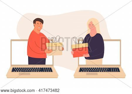 Happy People. Give Each Other Gifts. A Woman Gives A Man A Gift Via Laptop. The Guy Gives The Girl A