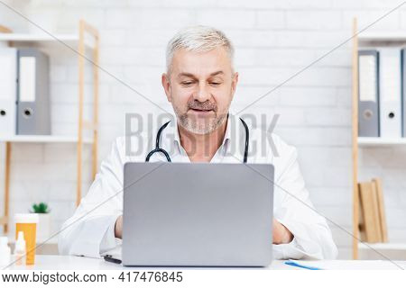 Family Doctor, Medical Specialist Or Therapist Advises Client Online, Internet Meeting For Patient