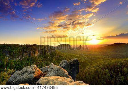 Saxon Switzerland Elbsandstone Sunrise At National Park Rock Peak Above Forest