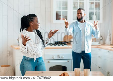 Domestic Fight. Portrait Of Annoyed Black Spouses Emotionally Arguing In Kitchen