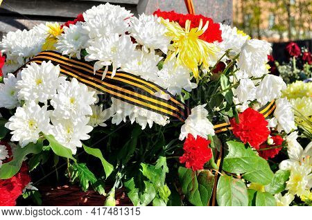 9 May holiday. 9 may background. 9 May outdoors.9 May holiday composition. Flowers with George ribbon at the celebration of May 9. Victory day 9 May holiday