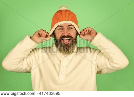 Feeling Good. Bearded Hipster. Hipster Style. Head In Warm Hat. Handsome Man Knitted Hat With Pom Po