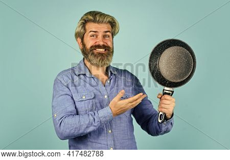 Posing In Kitchen. Bearded Man Presenting Cooking Pan. Cook Preparing Food Kitchen. Husband On Kitch