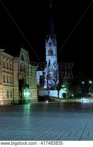 Government Building And The Tower Of A Catholic Church At Night In Vaduz In Liechtenstein 31.3.2021