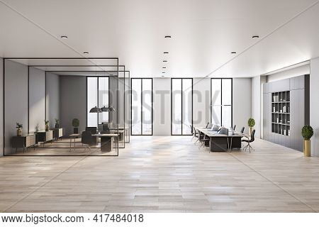 Modern Interior Design Of Spacious Office Hall In Skyscraper With Stylish Workspaces Divided By Glas