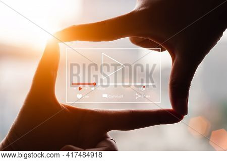 Concept Of Watching Live Video Online, Hands Making Framing View On Blurred Sunset Background.