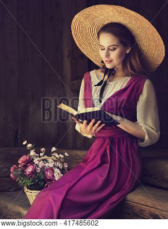 Romantic Vintage Woman Reading Book. Women Bible Study Over Dark Wooden Background. Victorian Era Po