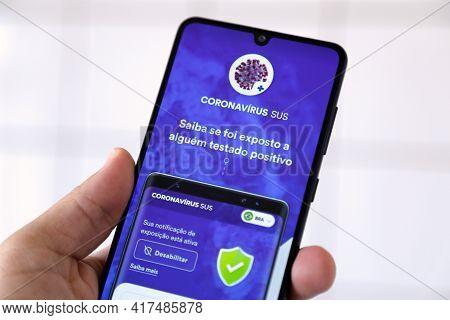 Minas Gerais, Brazil - April 19, 2021: Mobile Phone Screen With Coronavirus Sus Do Brasil Applicatio