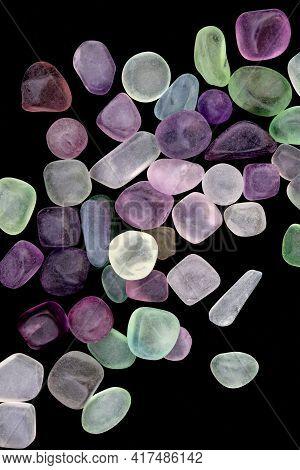 Fluorite Jewel Stones Heap Up Texture On Black Background