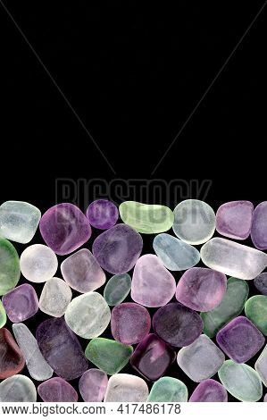 Fluorite Jewel Stones Heap Texture On Black Half Background. Place For Text.