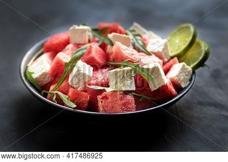Watermelon Salad With Feta Cheese, Arugula, Lime In Bowl. Natural Helthy Cuisine, Fresh And Tasty Ve