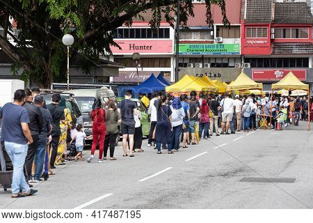 Kuala Lumpur, Malaysia, April 16, 2021: Shoppers Queing In Line To Enter Street Bazaar With Crowd Co