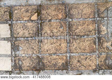 Old Beige Tiles On The Sidewalk Or Road, Worn Tiles.
