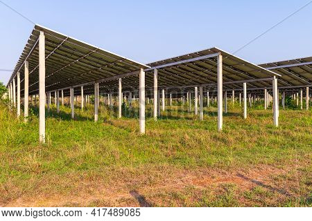 Solar Panel On Blue Sky Background. Landscape Of Solar Cell Farm. Clean Technology For Better Future