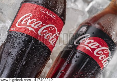 Coca-cola Logo On Classic Cola Bottles And Sugar-free On An Ice Cube Background. Thirst And Pleasure