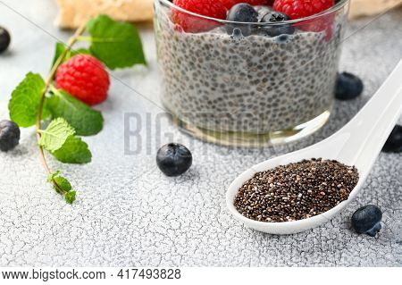 Chia Seeds With Healthy Chia Pudding With Coconut Milk And Fresh Berry In A Glass. Selective Focus,