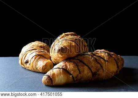 Croissant Basket. Freshly Baked Bread Or French Pastry Croissants With Jam On Black Bakery Table. Ta