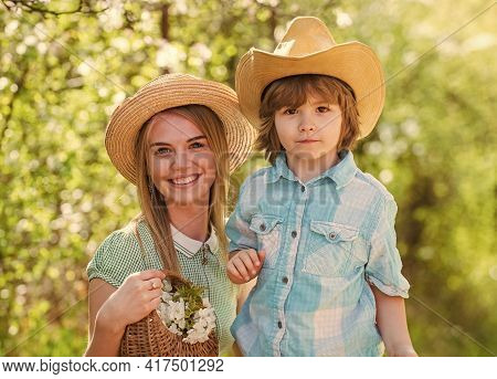 Portrait Mom And Little Son Outdoor. Cheerful Child With Mother Play Outdoors In Park. Mother With A