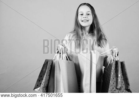 Kid Fashion. Shop Assistant With Package. Holiday Purchase Saving. Small Girl With Shopping Bags. Sa