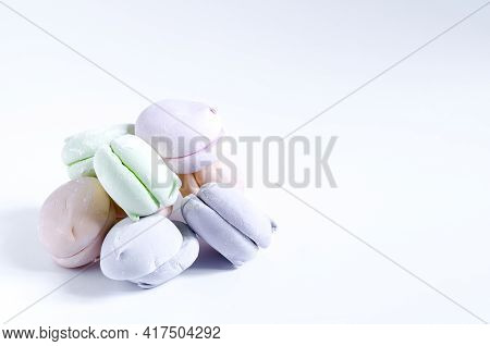 Sweet Airy Multi-colored Dessert On A Light Background Close-up Marshmallow