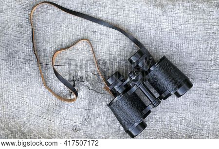 Vintage Binoculars On Wooden Background. Old Vintage Binoculars On Wooden Background