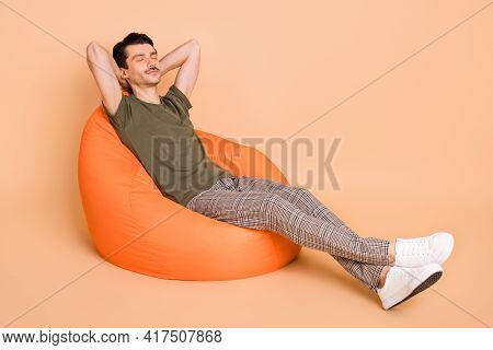 Full Size Photo Of Young Happy Dreamy Positive Man Sit Armchair Sleeping Daydreaming Isolated On Bei