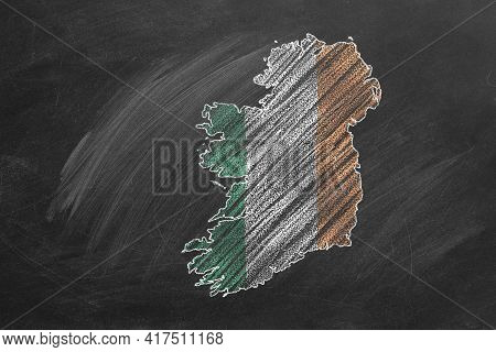Country Map And Flag Of Ireland Drawing With Chalk On A Blackboard. One Of A Large Series Of Maps An