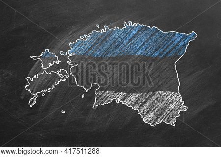 Country Map And Flag Of Estonia Drawing With Chalk On A Blackboard. One Of A Large Series Of Maps An