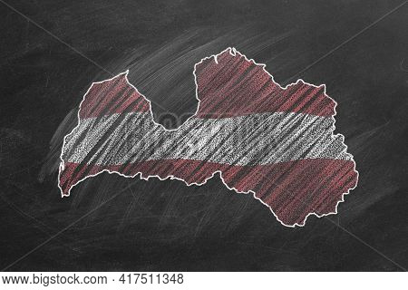 Country Map And Flag Of Latvia Drawing With Chalk On A Blackboard. One Of A Large Series Of Maps And