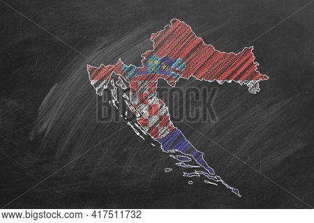 Country Map And Flag Of Croatia Drawing With Chalk On A Blackboard. One Of A Large Series Of Maps An