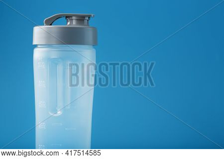 Shaker Is An Empty Plastic Smoothie Cup On A Blue Background.