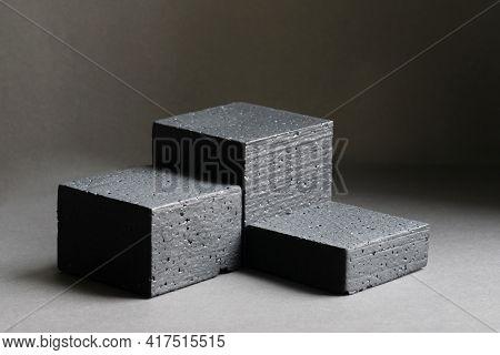 Black 3d Podium Made Of Geometric Shapes. Platforms For Product Presentation, Cosmetics. Monochrome