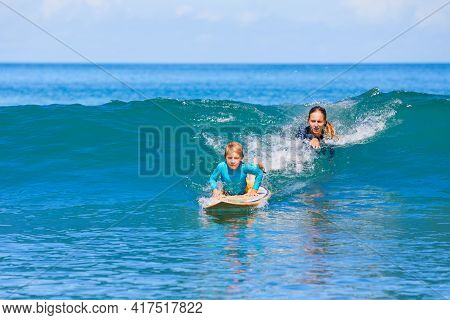 Little Surf Boy - Young Surfer Learn To Ride On Surfboard With Instructor At Surfing School. Active