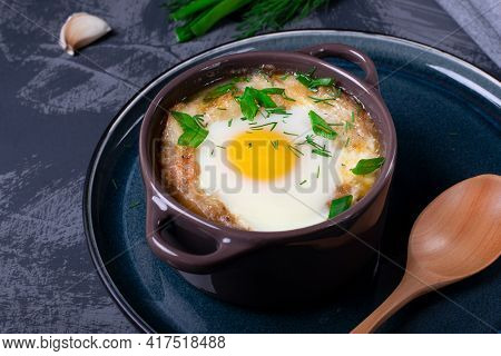 Garlic Bread Soup With Egg Baked In The Oven In A Portion Saucepan