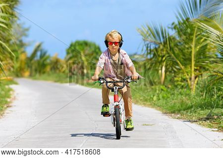 Country Cycling Walk. Young Rider Kid In Headphones And Sunglasses Riding Bicycle. Happy Child Have