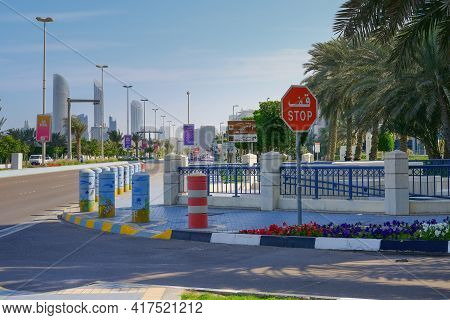 Stop Red Road Sign In Arab And English Language On Crossroad Before Worldwide Famous Scenic Corniche