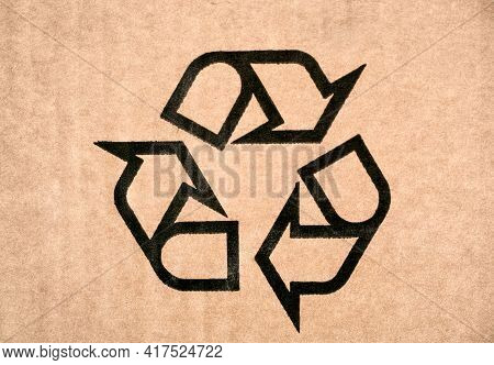 Recycling Symbol On Cardboard. Fragile Or Packaging Symbol. Close-up