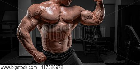 Powerful Bodybuilder Posing In The Gym. No Name Portrait. Bodybuilding Concept. Mixed Media