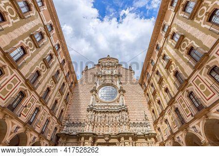 The Facade Of The Basilica In The Benedictine Abbey Of Montserrat (santa Maria De Montserrat) In Cat