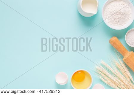 Ingredients For Baking On Light Blue Background, Space For Text.