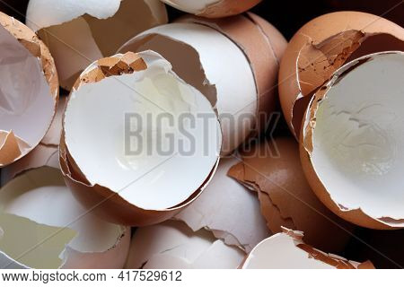 Broken Egg Shell On White Background. Top View. Egg Shell Texture. Organic Ingredient For Compost